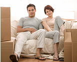 couple on couch, furniture removals, household movers, door-to-door, pack-your-own